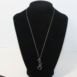 Jewelry - Sterling Silver black and white 3 hearts pendant